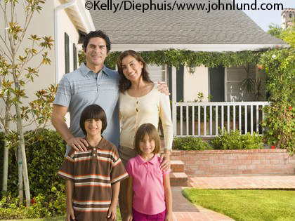 portrait of hispanic family in front of house